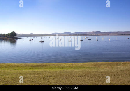View from grass verge of yachts moored on the Midmar dam in the natal midlands, Howick, KwaZulu-Natal South Africa - Stock Photo