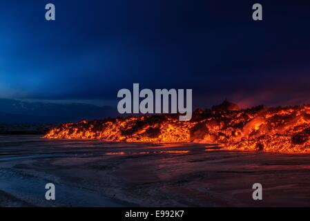 Glowing lava from the eruption at the Holuhraun Fissure, near the Bardarbunga Volcano, Iceland - Stock Photo