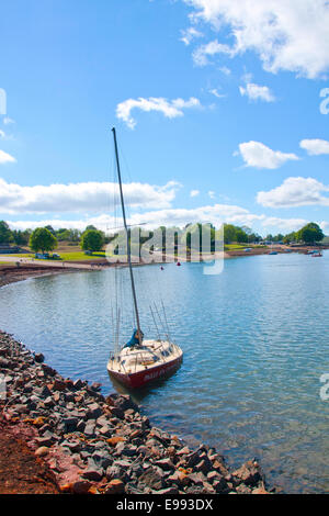 Yacht grounded on the banks of Midmar dam in the Midlands in KwaZulu, Natal, South Africa - Stock Photo