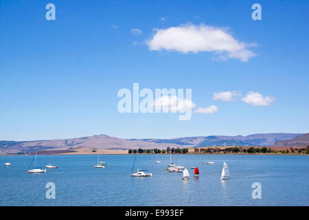 Over view of yachts in dam and cloudy blue sky landscape at Midmar Dam in the Midlands of KwaZulu Natal in South - Stock Photo