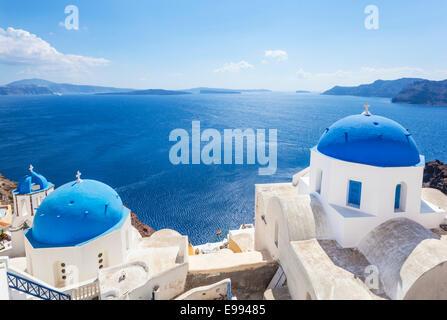 Traditional greek churches with three blue domes, Oia, Santorini, Thira, Cyclades Islands, Greek Islands, Greece, - Stock Photo