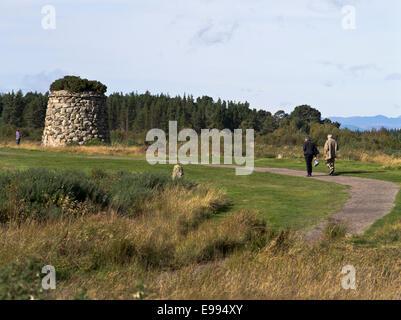 dh Culloden battlefield CULLODEN MOOR INVERNESSSHIRE Tourist couple walking Memorial stone cairn Highland Jacobite battle field