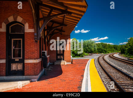 The historic railroad station along train tracks in Point of Rocks, Maryland. - Stock Photo