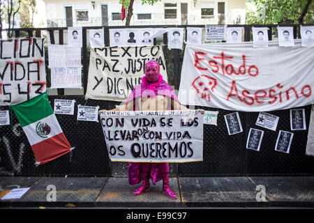 Buenos Aires, Argentina. 22nd Oct, 2014. A demonstrator takes part in a protest for the 43 missing students of the - Stock Photo