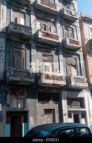 One of the many building in desperate need of repair and restoration in the Central part of the city of Havana Cuba - Stock Photo