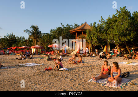 Beach of Kuta at sunset. Surfing lessons. Bali. Kuta is a coastal town in the south of the island of Lombok in Indonesia. - Stock Photo