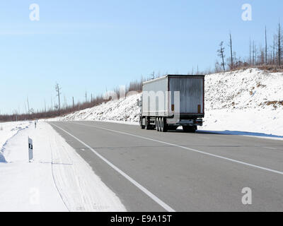 The truck on a winter road. - Stock Photo