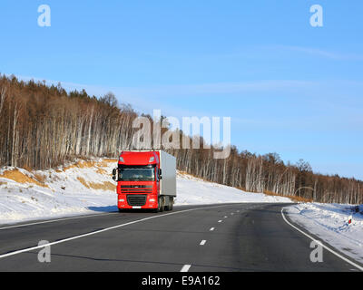 The red truck on a winter road. - Stock Photo
