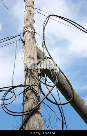 wooden pole with wires - Stock Photo