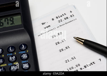 Calculator is located on a bank statement
