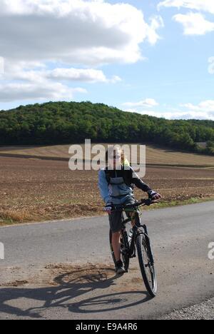 teenager cycling - Stock Photo