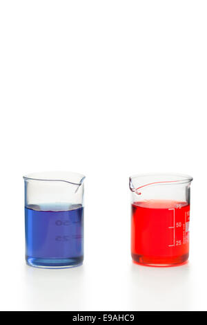 Blue and red liquid in beakers - Stock Photo