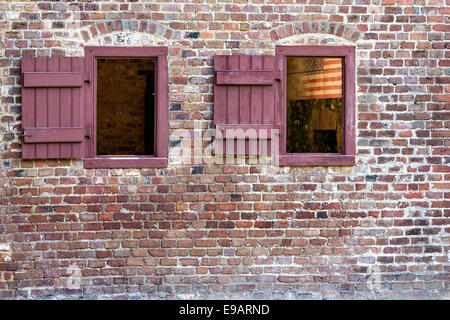 Windows on a civil war era slave cabin at Boone Hall Plantation in Mt Pleasant, South Carolina. - Stock Photo