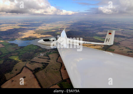 Glider or sailplane, type ASH 26 E, updrafts stretching to the horizon, thermal energy roads, Wismar - Stock Photo