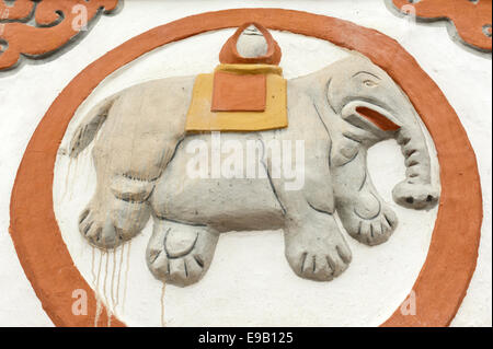 Buddhist Stupa, detail, lucky symbol of an elephant, Sungda Chorten in Charang, Upper Mustang, Nepal, Asia - Stock Photo