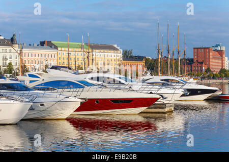 Yachts and pleasure boats moored in central marina of Helsinki, Finland - Stock Photo