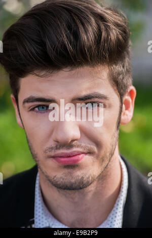 Young and handsome blue eyed man portrait - Stock Photo