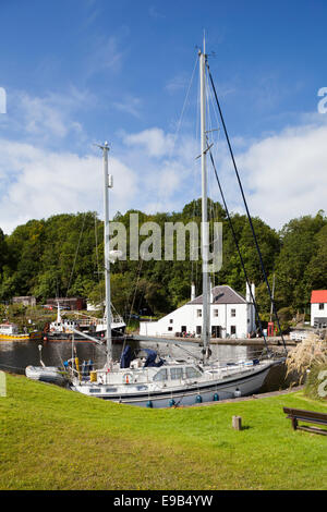 A yacht moored in the canal basin on the Crinan Canal at Crinan, Knapdale, Argyll & Bute, Scotland UK - Stock Photo