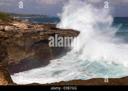 Wave crashing against rocky outcrop of 'Devil's Tears', [Nusa Lembongan], Bali, Indonesia - Stock Photo