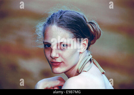young female aspiring model poses for portfolio photographs during the 1990s - Stock Photo