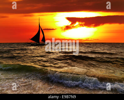 Tropical sunset with sailboat, Boracay, Philippines - Stock Photo