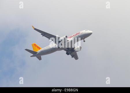 ISTANBUL, TURKEY - JULY 13, 2014: Pegasus Airlines Airbus A320-214 landing to Sabiha Gokcen Airport. Pegasus is - Stock Photo