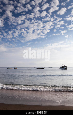 Cloudy blue sky and sea, Pemuteran beach, Bali, Indonesia - Stock Photo
