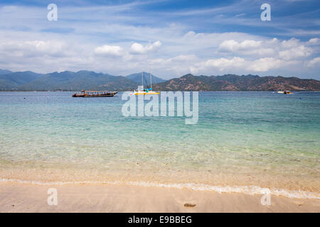 Clear blue water and tropical beach, sea view to Lombok from 'Gili Air', 'Gili Islands', Indonesia - Stock Photo