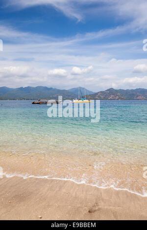 Tropical beach and clear blue sea, 'Gili Air', 'Gili Islands', Lombok, Indonesia - Stock Photo