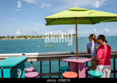 Florida Key West Sunset Key Gulf of Mexico Sunset Pier restaurant bar pub tables umbrellas colorful Westin Key West - Stock Photo