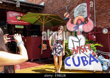 Florida Key West Mallory Square El Meson de Pepe Cuban restaurant William Wall Warehouse woman posing picture smartphone - Stock Photo