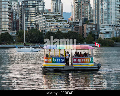 An Aquabus ferry boat transports passengers on False Creek's waterway, Vancouver, Canada - Stock Photo