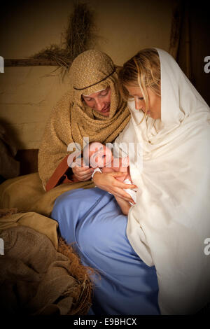 Reenactment of the christmas nativity scene with real people - Stock Photo
