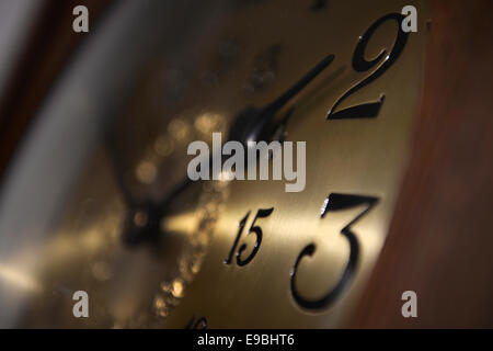 Ravensburg, Germany. 23rd Oct, 2014. A lightbeam of a lamp marks one of the hands of an antique long case clock - Stock Photo