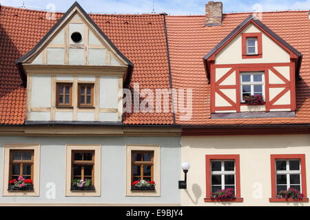 Traditional timbered house with red roof clay tiles - Stock Photo