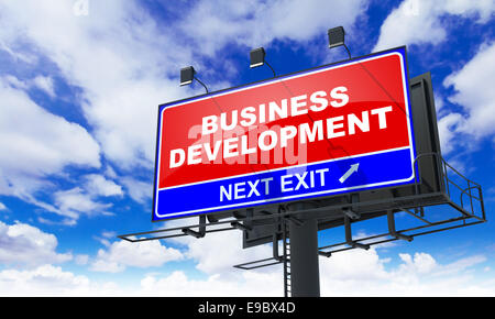 Business Development Inscription on Red Billboard. - Stock Photo