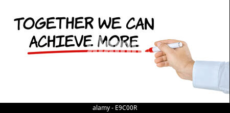Hand with pen writing Together we can achieve more - Stock Photo
