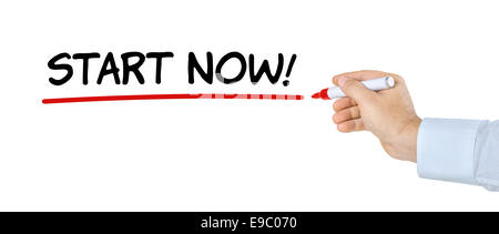 Hand with pen writing Start now - Stock Photo