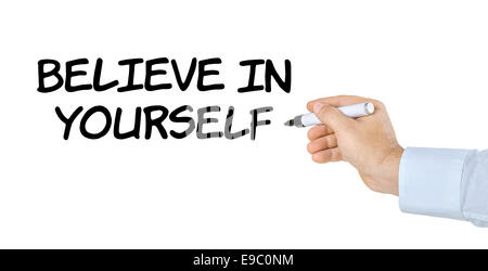 Hand with pen writing Believe in yourself - Stock Photo