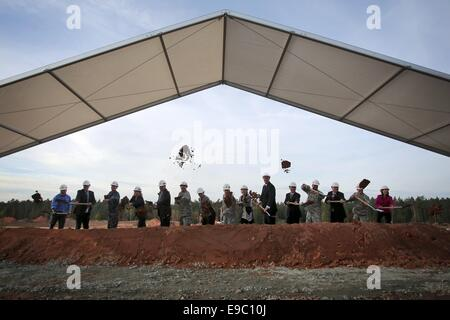 Weilerbach, Germany. 24th Oct, 2014. Politicians and military members dig at the site of the new 'ROB (Rhine Ordnance - Stock Photo