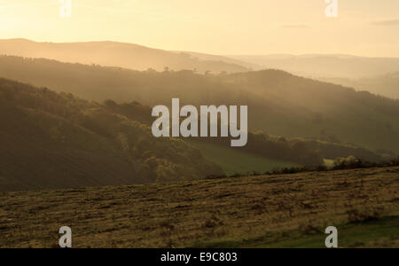 Autumnal sunset with misty light over the Usk Valley near Brecon in Wales - Stock Photo