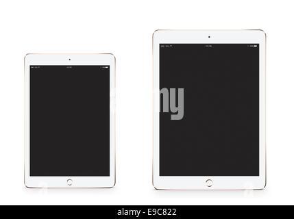 Tablets iPad mini 3 iPad air 2 gold with blank screen, digitally generated artwork. - Stock Photo