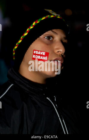 Copenhagen, Denmark. 24th Oct, 2014. Kurdish boy with a tattoo in support of his suffering people in the war-torn - Stock Photo