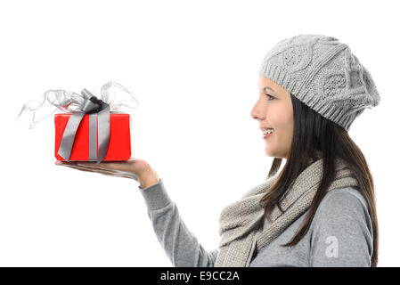 Close up Smiling Middle Age Woman in Side View Wearing Gray Winter Fashion Showing Small Red Present on Hand, isolated - Stock Photo