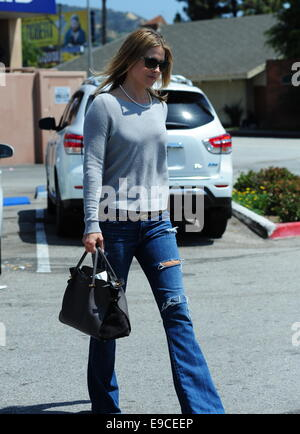 Ali Larter wearing flared ripped jeans leaves Rite Aid Featuring ...