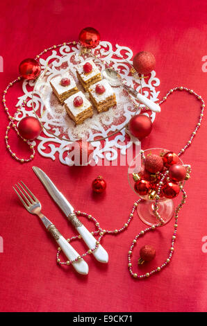 Holiday apple pie bars, garnished with fresh raspberries Near Christmas decorations.  From series Winter pastry - Stock Photo