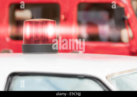 Detail of Flashing Red Siren Light on Roof of Emergency Vehicle - Stock Photo
