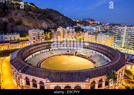 Malaga, Spain cityscape and bullring at Plaza del Toros. - Stock Photo