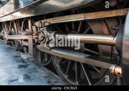 Closeup of the connecting rods and pistons of a steam locomotive - Stock Photo