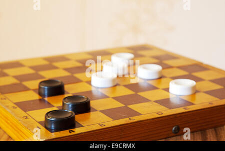 black and white checkers on a chess board closeup - Stock Photo